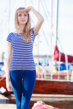 Woman in marina against yachts in port Royalty Free Stock Photography