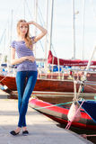 Woman in marina against yachts in port Stock Image