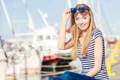 Woman in marina against yachts in port Stock Photos