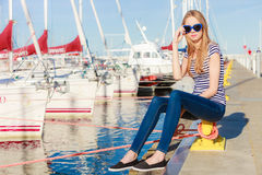 Woman in marina against yachts in port Stock Photo