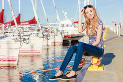 Woman in marina against yachts in port Royalty Free Stock Image