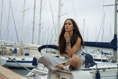 Woman in marina Stock Image