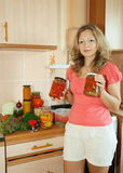 Woman with marinated vegetables Stock Photo