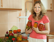 Woman with marinated vegetables stock photography