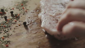 Woman marinating steak stock video footage