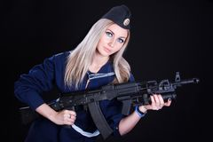 Woman in the marine uniform with an assault rifle Stock Photography