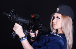 Woman in the marine uniform with an assault rifle Royalty Free Stock Photo