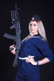 Woman in the marine uniform with an assault rifle Stock Image