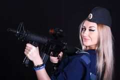 Woman in the marine uniform with an assault rifle Stock Photos