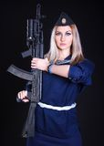 Woman in the marine uniform with an assault rifle Royalty Free Stock Photography