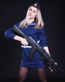 Woman in the marine uniform with an assault rifle Royalty Free Stock Images