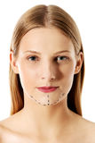 Woman marked out for cosmetic surgery. Isolated on white. Royalty Free Stock Photography