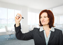 Woman with marker Royalty Free Stock Image