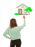 Woman with marker drawing house Stock Photography