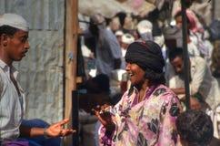 Woman at a market in Bait al Faki, Yemen. Woman bargaining with a man at a market in Bait al Faki, Yemen Royalty Free Stock Image