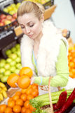Woman at the market.She is buying fresh fruits at a market. Royalty Free Stock Image