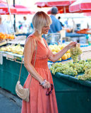 Woman on market place Royalty Free Stock Photo