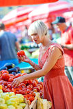 Woman on market place with vegetables Stock Photography