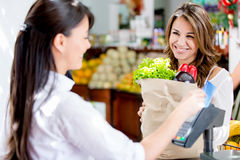 Woman at the markets checkout Royalty Free Stock Photography