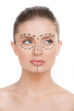 Woman with markings on face. Royalty Free Stock Photography
