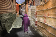 Woman in Marrakesh in traditional crimson dress Royalty Free Stock Photo