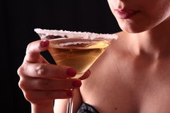 Woman and martini glass Stock Photography