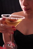Woman and martini glass Royalty Free Stock Photos