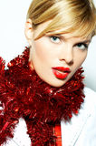 Woman with X-mas tinsel Royalty Free Stock Photos