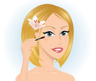 Woman with a mascara. Stock Photo