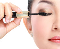 Woman with mascara Stock Photography