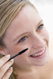 Woman with mascara wand Stock Photography