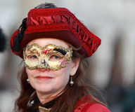 Woman with a mask. Venice,Italy- February 25th, 2011: Portrait of a woman wearing a mask in Venice during the carnival days.The Carnival of Venice (Carnevale di royalty free stock photography