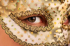 Woman in Mask. Woman wearing a white and gold decorated mask stock photos