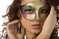 Woman in the mask. Beautiful woman in the masquerade mask close-up portrait Stock Photo