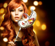 Woman with the mask. Beautiful Woman with the Carnival mask royalty free stock image