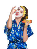 Woman with a mask. Beautiful young woman with a mask on her face eats strawberry isolated over white stock photos