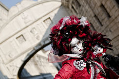 Woman with mask and bridge of sighs. Woman with mask at carnival of venice with behind the bridge of sighs Royalty Free Stock Image