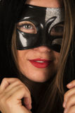 Woman mask cloak lipstick close looking Royalty Free Stock Image