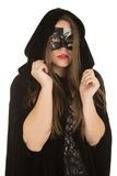 Woman mask cloak lipstick hands up Stock Photography