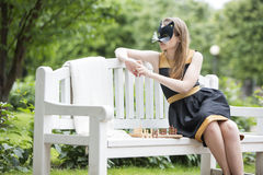 Woman  with mask and costume on bench Royalty Free Stock Photos