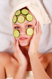 Woman in mask from cucumber Royalty Free Stock Photo
