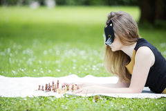 Woman  with mask decide move chess piece Stock Photos