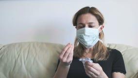 Woman mask drugs - woman sick health care emergency with pills blister - useless coronavirus antibiotics against covid