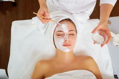 Woman in mask on face in spa beauty salon.  Royalty Free Stock Images