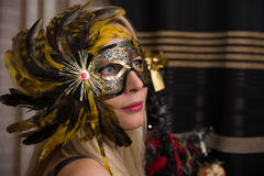 Woman in mask with focus on left eye Royalty Free Stock Photo
