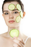 Woman with mask from a fresh cucumber Royalty Free Stock Image
