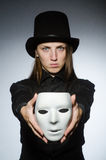 The woman with mask in funny concept. Woman with mask in funny concept Stock Photography