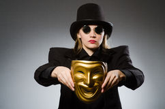 The woman with mask in funny concept Royalty Free Stock Photos