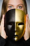 The woman with mask in funny concept. Woman with mask in funny concept Royalty Free Stock Photos