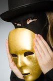 The woman with mask in funny concept Stock Photo
